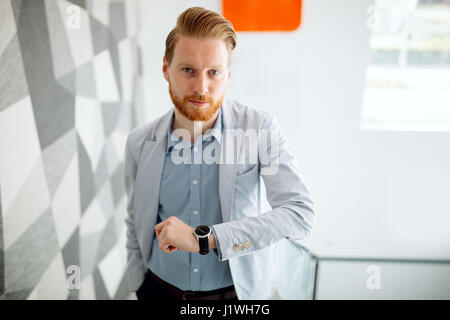 Red haired businessman with beard - Stock Photo