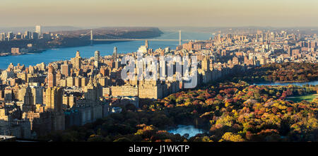 Panoramic elevated view of Central Park, Upper West Side and the George Washington Bridge with Hudson River in Fall. - Stock Photo