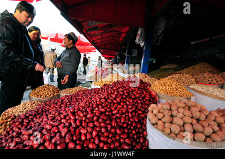 Dried fruits and nuts sold in the colorful and vibrant markets of Kashgar. - Stock Photo
