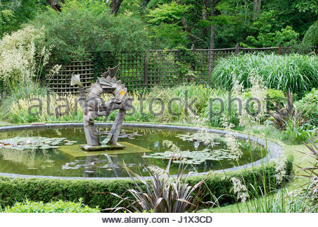 ... GARDEN DORSET; DRAGON SCULPTURE BY SUSAN FORD (WITH ST. DUNSTAN AS PART  OF THE SCULPTURE)