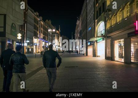 Munich-Bavaria-Germany. March 29, 2017. Night view of Kaufinger street with people walking. Near the Marienplatz - Stock Photo