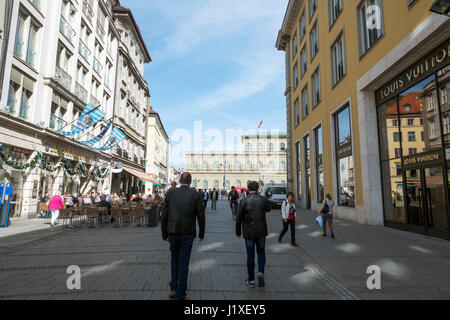 Munich-Bavaria-Germany. March 29, 2017. View of Residenz street with people strolling and drinking beer on terraces. - Stock Photo