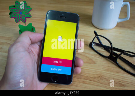 Bangkok, Thailand - April 22, 2017 : Apple iPhone5s showing its screen with Snapchat application. - Stock Photo