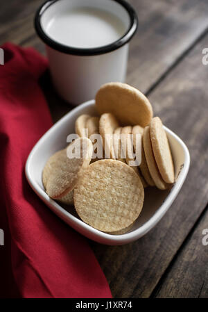Organic, gluten free sugar cookies with milk on the  table - Stock Photo