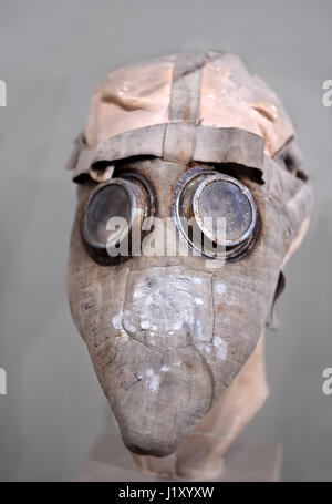 Old rustic gas mask (respirator) - Stock Photo