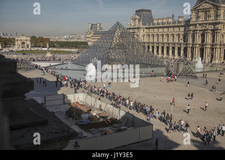 People queue in morning to buy ticket to entry to The Louvre Museum/ in Paris - Stock Photo