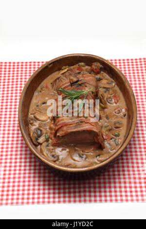 Schweinefilet im Speckmantel - Stock Photo