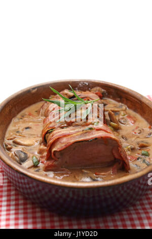 Schweinefilet im Speckmantel - Stock Photo