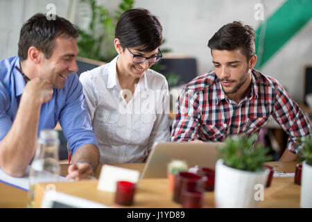 businessman  and students smiling talking  in coffee shop - Stock Photo