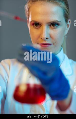 Smiling woman lab technician in laboratory - Stock Photo