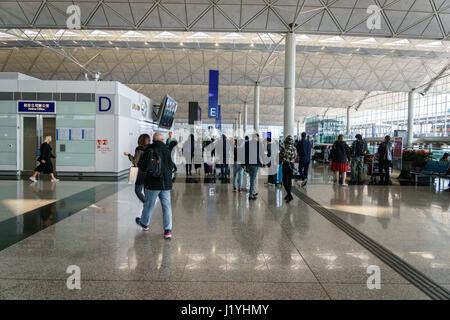 Hong Kong - circa March 2017: Departure terminal area of Hong Kong International Airport. It is the main airport - Stock Photo