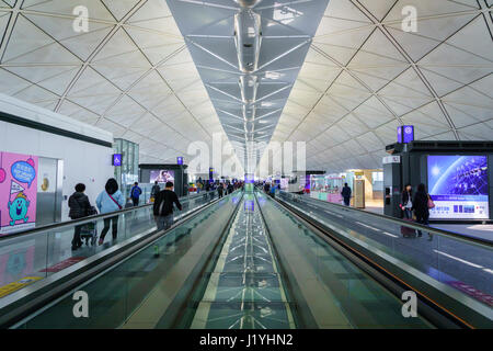 Hong Kong - circa March 2017: Departure gate area inside of Hong Kong International Airport. It is the main airport - Stock Photo