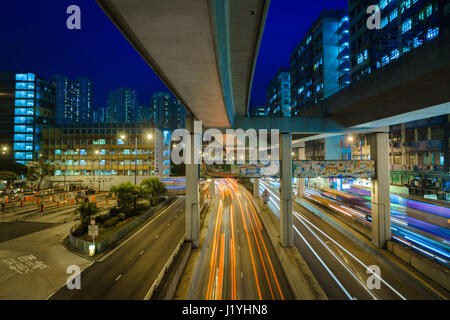 Hong Kong traffic night view with traffic light tracks. - Stock Photo