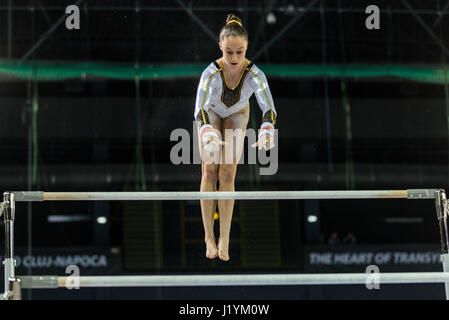 Cluj Napoca, Romania. 22nd Apr, 2017. Nina Derwael from Belgium competes at the asymmetrical bars at the UEG European - Stock Photo