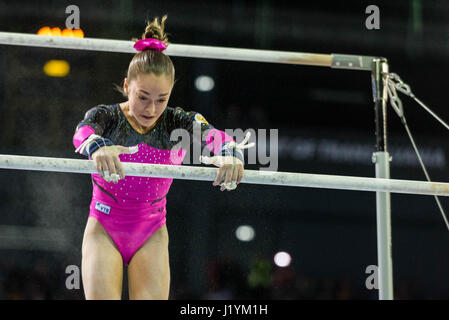 Cluj Napoca, Romania. 22nd Apr, 2017. Jelena Jeremina from Russia competes at the asymmetrical bars at the UEG European - Stock Photo