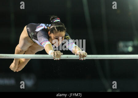Cluj Napoca, Romania. 22nd Apr, 2017. Kim Bui from Germany competes at the asymmetrical bars at the UEG European - Stock Photo
