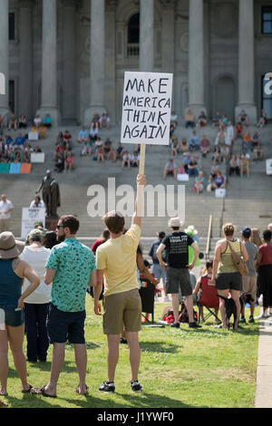 Columbia, USA. 22nd April, 2017. A demonstrator holds a Make America Think Again sign at The South Carolina State - Stock Photo