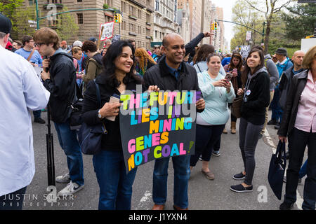 New York, USA. 22nd April, 2017. An unidentified man and woman hold a sign that reads 'The Future Lies In Mining - Stock Photo