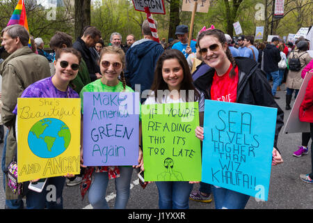 New York, USA. 22nd April, 2017. A group of unidentified young women holds signs during the March For Science on - Stock Photo