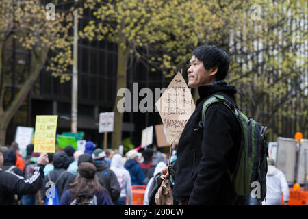 Seattle, Washington,USA. 22nd April, 2017. Bingram L. holds a protest sign at Seattle Cinerama. The March for Science - Stock Photo