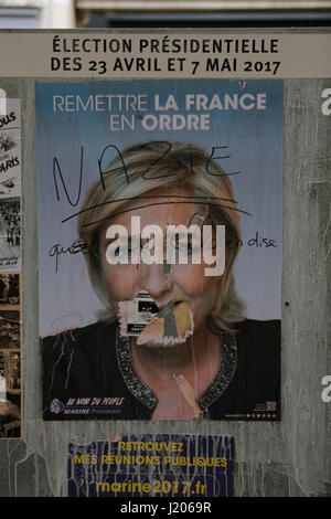 Paris, France. 22nd Apr, 2017. An election poster from Marine Le Pen from the Front National party has been defaced - Stock Photo