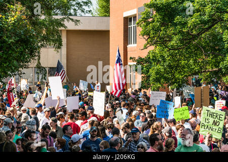 Protesters hold signs high at the Raleigh March for Science held on April 22, 2017. The march kicked off here at - Stock Photo