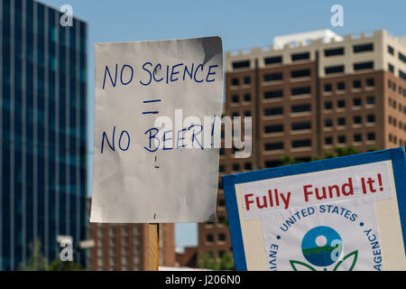 Protesters hold signs high at the Raleigh March for Science held on April 22, 2017. - Stock Photo
