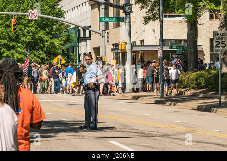 A cop stands ready to keep order at the Raleigh March for Science on April 22, 2017 - Stock Photo