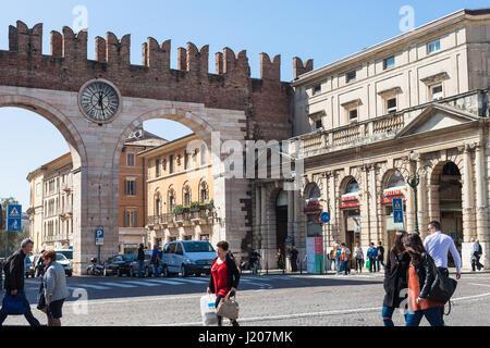 VERONA, ITALY - MARCH 29, 2017: people, Corso Porta Nuova street and medieval Bra Gates (Portoni della Bra) on Piazza - Stock Photo