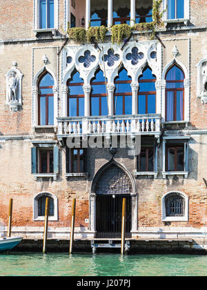 VENICE, ITALY - MARCH 30, 2017: facade of palace Loredan dell'Ambasciatore on Grand Canal in Venice city in spring. - Stock Photo