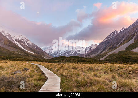 Sunrise, trail through Hooker Valley, at back Mount Cook, Mount Cook National Park, Southern Alps, Canterbury Region, - Stock Photo