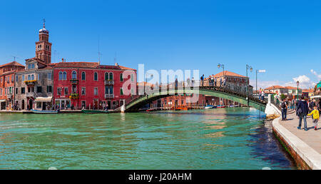 MURANO, ITALY - APRIL 20, 2016: Panoramic view of old colorful houses and bridge over canal in Murano - series of - Stock Photo