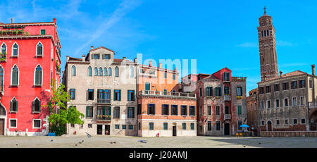 Panoramic view of small town square and old colorful houses in Venice, Italy. - Stock Photo