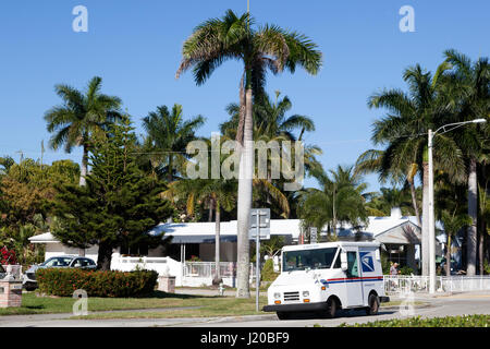 Hollywood, Fl, USA - March 21, 2017: United States Postal Service (USPS) truck delivering in a residential neighborhood - Stock Photo