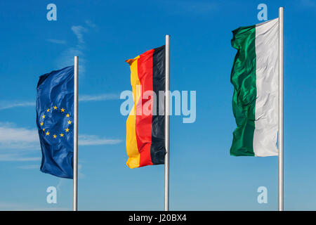 The flags of the Free State of Saxony, of Germany and of the European Union side by side - Stock Photo