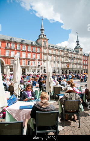 People sitting on terraces at Main Square. Madrid, Spain. - Stock Photo