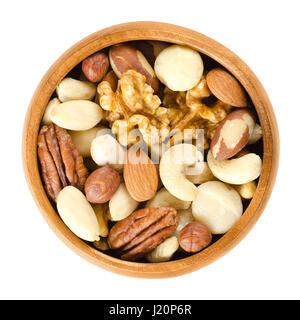 Raw mixed nuts in wooden bowl. Dried walnuts, hazelnuts, almonds, cashews, macadamia, Brazil and pecan nuts. Fancy - Stock Photo