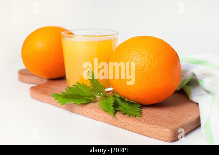 Glass of orange juice on wooden table, fresh drink - Stock Photo