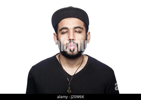Portrait of young man with black t-shirt and cap kissing with closed eyes. studio shot, isolated on white background. - Stock Photo