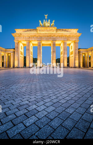 Classic vertical view of historic Brandenburg Gate, Germany's most famous landmark and a national symbol, in post - Stock Photo