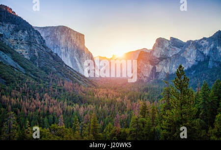 Classic Tunnel View of scenic Yosemite Valley with famous El Capitan and Half Dome rock climbing summits in beautiful - Stock Photo