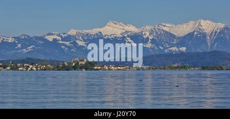Springtime at lake Zurichsee. Rapperswil and snow capped mountain Grosser Speer. - Stock Photo