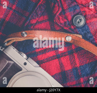 Rustic Plaid Shirt With Retro Vintage Camera And Leather Strap - Stock Photo