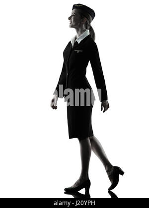 one caucasian Stewardess cabin crew  woman walking isolated on white background in  silhouette - Stock Photo