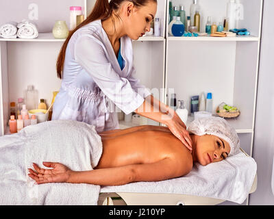 Massage therapy deals. Woman therapist making manual therapy back. - Stock Photo