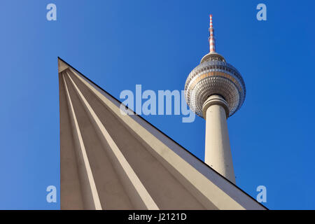 Low angle view of Communications Tower / Television Tower (Fernsehturm) against clear blue sky. Alexanderplatz, - Stock Photo