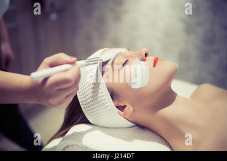 Professional cosmetic and massage treatment at wellbeing saloon - Stock Photo