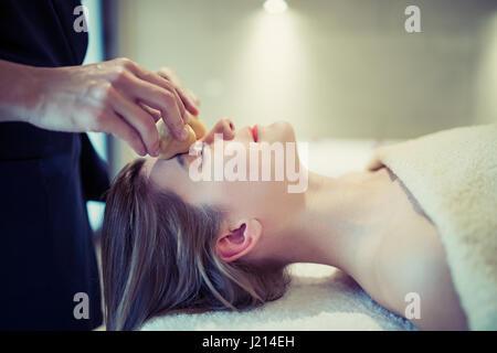 Relaxing anti stress facial massage at resort - Stock Photo