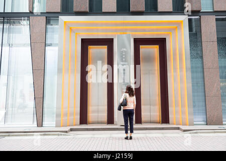 TOKYO, JAPAN - 24th June 2016: Customer waits for the external lift at he iconic De Beers buildings in the exclusive - Stock Photo