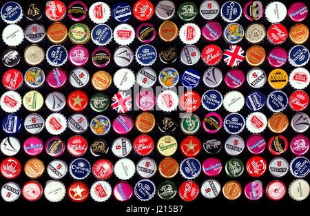 SOUTHAMPTON, UK - 21 Jan 2017: A background of bottle caps from a variety of popular beers, lagers and ciders from - Stock Photo